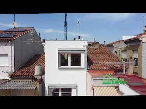 Vivienda entre medianeras 3 plantas estructura madera Sabadell