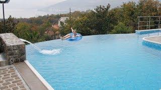 kid falls off swimming pool edge...