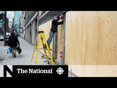 Anti-curfew protesters damage businesses in Montreal