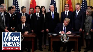 Download Trump signs 'phase one' of China trade deal Mp3 and Videos