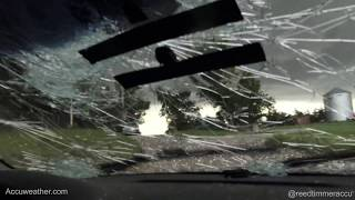 Grapefruit size HAIL busting out windshield near Fort Laramie, Wyoming!