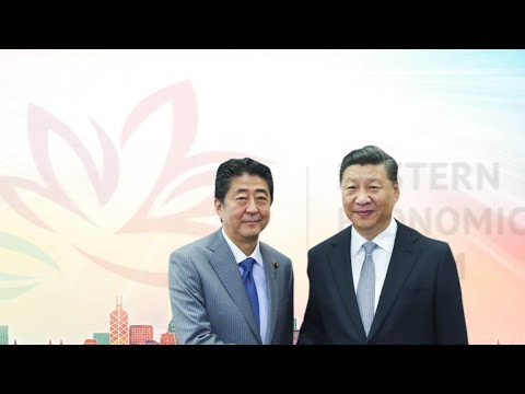 Xi, Abe meet on further improving China-Japan ties