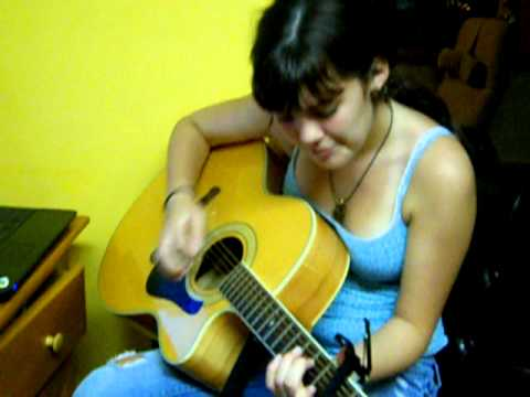 15 year old Emily singing and praticing guitar