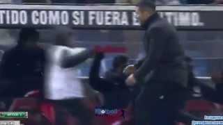 Diego Simeone celebrates goal with Atletico Madrid ball boy/his son vs. Real Madrid