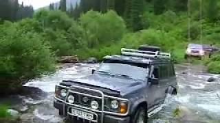 Off-road test drive of Nissan Safari crossing a Kensu river ford