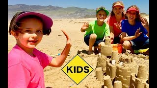 Sign Post Kids! Sand Castle Toys at the Beach!