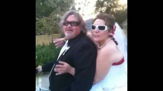 Paolina and Joseph sitting on his Harley after their wedding