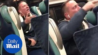 Raging passenger shouts racist tirade at two black girls on LIRR - Daily Mail