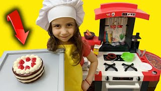 Hafsa cooks with her toy kitchen  !!
