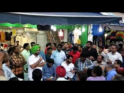 At Ajmal Khan road with trader's
