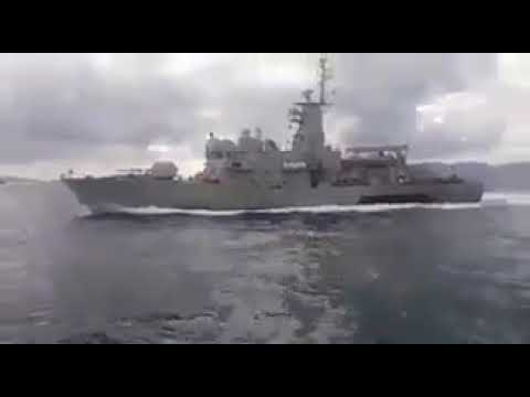 Greek Navy boat harrasing a Turkish ship near Kardak rocks in Aegean Sea.