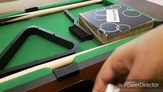 unboxing the mini table top pool table