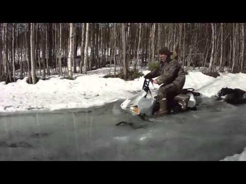 Снегоход Рыбинка по мокрому снегу