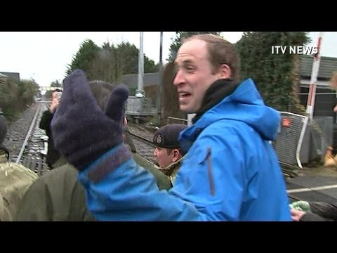 Prince William has a go at journalists after helping flood victims