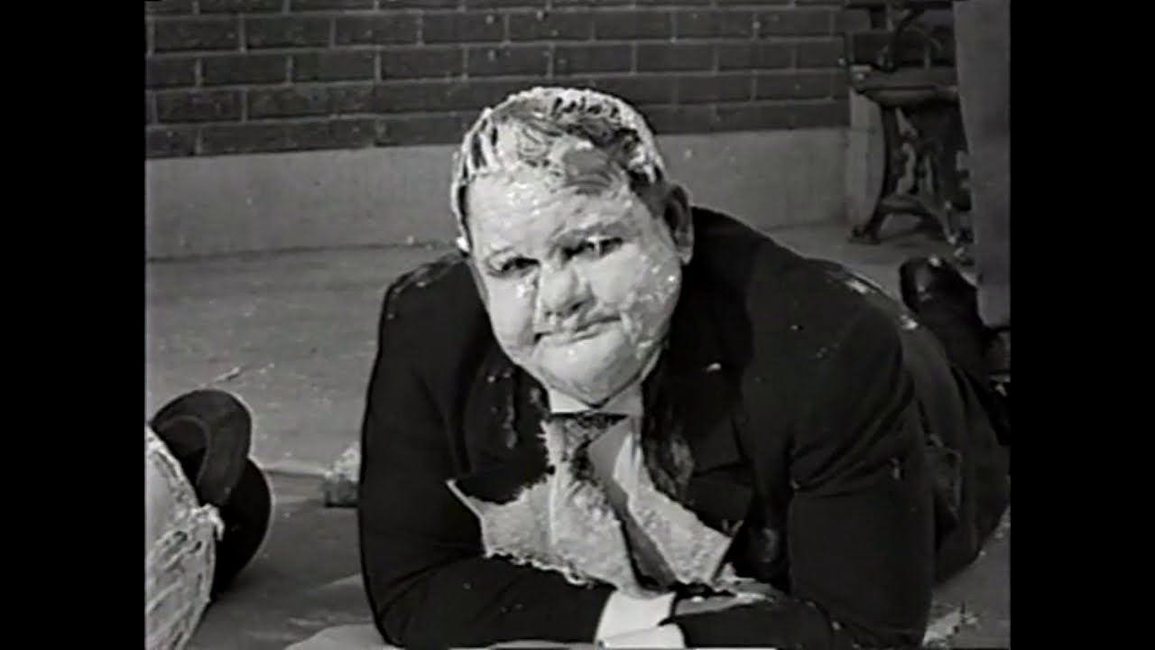Download Laurel and Hardy Poster Sticking! Funny Scene from Air Raid Wardens (1943).