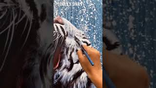 Don't miss the life-like tiger under the painter's seemingly random techniques.