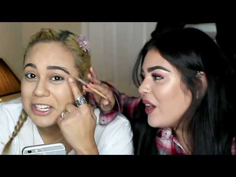 my drunk friend does my makeup!!! yikes...