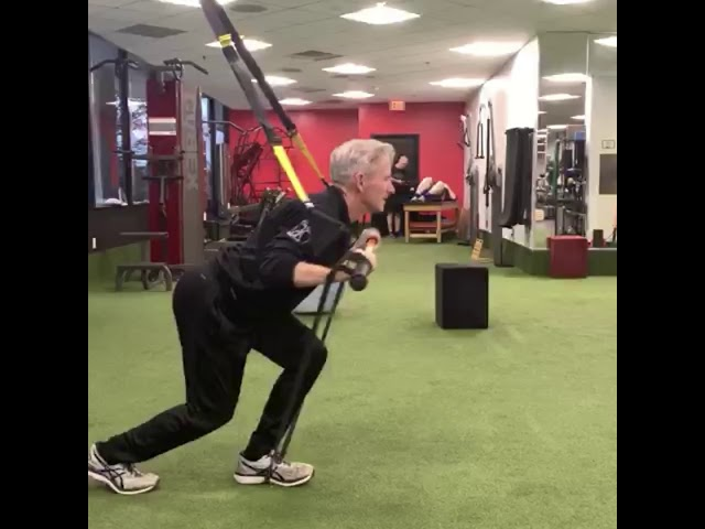 Single-leg Push Press with TRX and Stick Mobility
