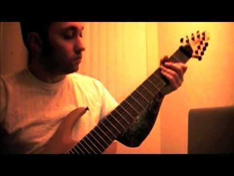 Mike Gianelli playing on an Agile 8 string guitar.