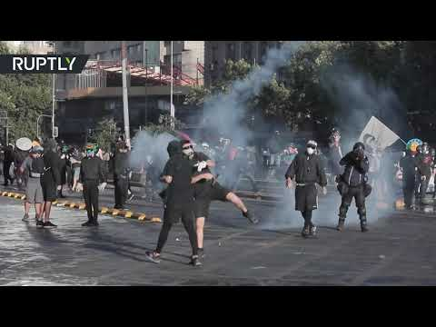Mayhem in Santiago | Protesters dispersed with water cannons & tear gas