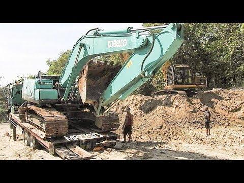 Kobelco SK200 Excavator Trip By Fuso Self Loader Truck