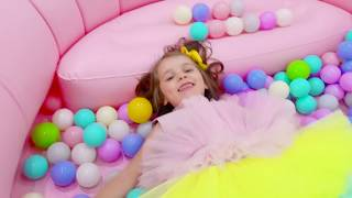 Katy and daddy play with giant inflatable pool