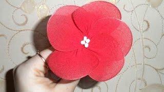 Как изготовить искусственные цветы  из капрона(Изготовление искусственных цветов из ткани. Смотрите мастер класс, в котором вы узнаете, как подарить колго..., 2014-09-15T06:23:18.000Z)