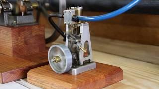 Tiny model steam engine.