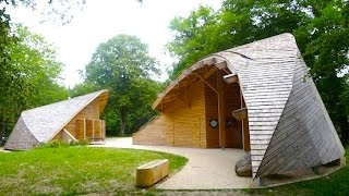 Dome-Shaped Eco-Tourism Center in France is a Living Room in the Woods