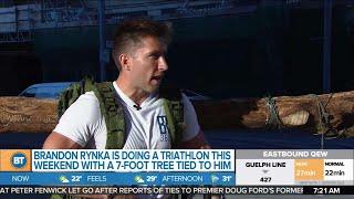 'Treeathlete' Brandon Rynka is wearing a 7-foot tree