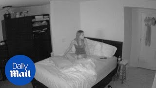 Footage captures ghost-like activity while woman sleeps - Daily Mail