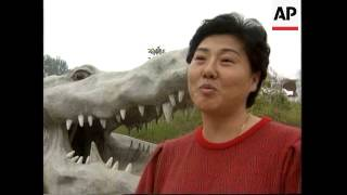 CHINA: BEIJING: CROCODILE ZOO: VISITORS CAN FEED LIVE BIRDS TO CROCS