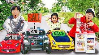 Boram et DDoci voient des énormes jouets de voitures motorisées dans