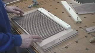 In this video, I start with rough lumber and mill it down to make the slats for the tambour door. Then place them in a jig, glue on the