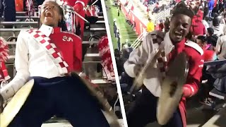 Watch This Cymbal Player's Crazy Moves at Football Games