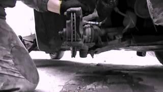 Замена передних тормозных дисков Opel Vectra A