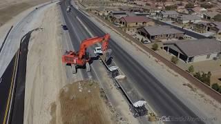 Droning a HITACHI EX1200 loading highway trucks