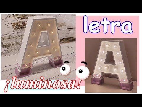Light letter made of DIY carton. Decorative lamp. 3D letters