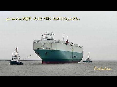 car carrier FRISIA 3EAF4 IMO 8415809 arrival with tugs Emden Germany Autotransporter und Schlepper