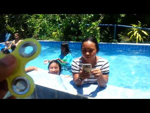 They do music.ly  in swimming pool