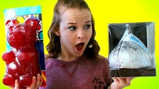 WORLD'S BIGGEST CANDY!  Giant Gummy Bear, Hershey's Kiss, Lollipop, & More! | Emma Monden