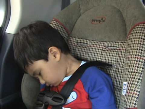Child Sleeping In Car Seat With His Head Bobbing And Slumping