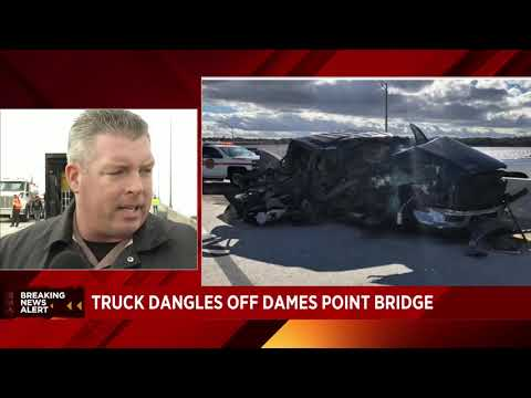 Crash leaves semi dangling off Dames Point Bridge