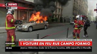 Une voiture en feu rue Campo Formio