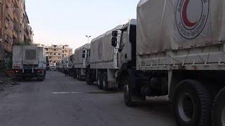 قافلة مساعدات أممية تدخل حي الوعر في مدينة حمص