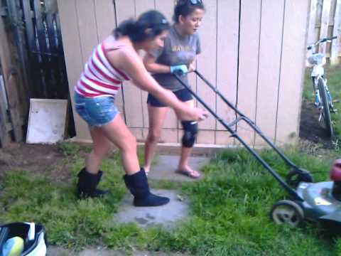 two girls mow lawn