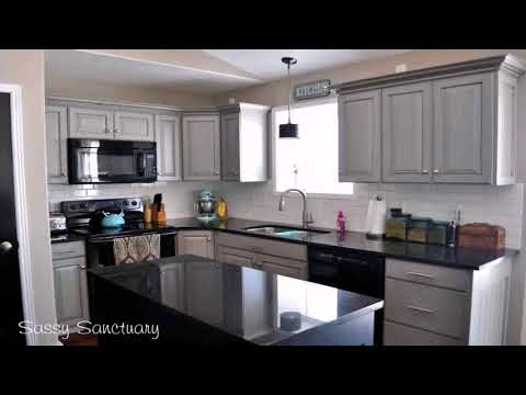 kitchen-with-grey-cabinets-and-black-appliances---gif-maker-daddygif.com-(see-description)