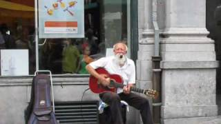 Old man playing blues on the street in Brussels.