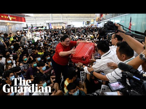 Hong Kong airport protesters block travellers from entering departure gates