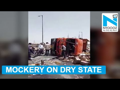 Truck, carrying liquor, overturns in dry state Gujarat